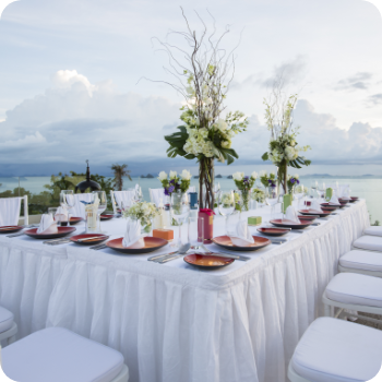 decorated restaurant venue for wedding ceremony with tables and chairs